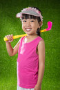 Asian Chinese little girl playing golf Royalty Free Stock Photo