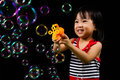 Asian Chinese Little Girl Playing Soap Bubbles Royalty Free Stock Photo