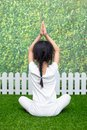 Asian Chinese little girl practicing yoga pose on a mat Royalty Free Stock Photo