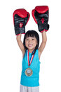 Asian Chinese little girl wearing boxing gloves and celebrating Royalty Free Stock Photo