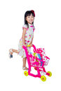 Asian Chinese little girl wearing cheongsam pushing toy trolley Royalty Free Stock Photo