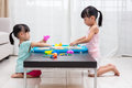 Asian Chinese little girls playing kinetic sand at home Royalty Free Stock Photo