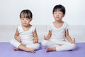 Asian Chinese little girls practicing yoga pose Royalty Free Stock Photo