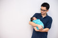Asian chinese newborn baby girl and daddy in hospital photo Stock Photography