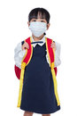 Asian Chinese school girl with school bag and wearing mask Royalty Free Stock Photo