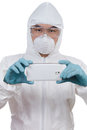 Asian Chinese scientist in protective wear with mobile phone