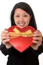 Asian chinese woman holding heart shape box beautiful anniversary on valentines day present isolated on white background Stock Image