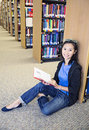 Asian collage student in the library a portrait of an smiling beautiful college studying Royalty Free Stock Photography