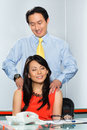 Asian colleagues having office affair business women or secretary a massage and an or relationship with her boss or colleague in Royalty Free Stock Photography