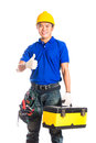 Asian construction worker with tools indonesian builder or helmet and tool belt sitting on tool box Royalty Free Stock Images