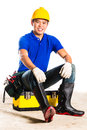 Asian construction worker with tools indonesian builder or helmet and tool belt sitting on tool box Stock Photo
