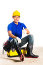 Asian construction worker with tools indonesian builder or helmet and tool belt sitting on tool box Stock Image