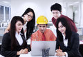 Asian contractor explaining to team at office male is his plan workplace Royalty Free Stock Photo