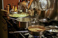 Asian cooking meal with noodles and peanut sauce cooked on a stove Stock Images