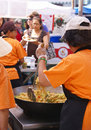 Asian cooks serving food at concessions. Royalty Free Stock Photo