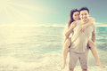Asian couple on beach Royalty Free Stock Photo