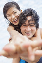 Asian couple at beach taking selfie photograph man women boyfriend girlfriend in bikini vacation the Royalty Free Stock Photos
