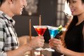 Asian couple clinking their glasses in the bar Royalty Free Stock Photography