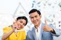 Asian couple with folding rule in furniture store Stock Photos