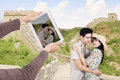 Asian couple at great wall of china take picture Royalty Free Stock Image
