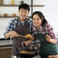 stock image of  Asian couple are happy to cook together in the morning