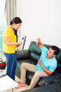 Asian couple having relationship difficulties young handsome with household tasks like vacuum and playing games on couch Stock Images