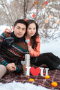 Asian couple in love on snow background Stock Photos