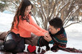 Asian couple in love on snow background Royalty Free Stock Images