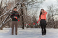 Asian couple in love on snow background Stock Images