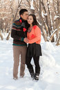 Asian couple in love on snow background Royalty Free Stock Photos