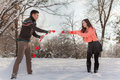 Asian couple in love on snow background Stock Photography