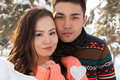 Asian couple in love on snow background Royalty Free Stock Photography