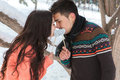 Asian couple in love on snow background Stock Photo