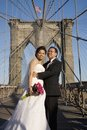 Asian couple married on Brooklyn Bridge Royalty Free Stock Images