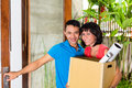 Asian couple moving in the new home real estate market young indonesian a or apartment with a packing case or box Royalty Free Stock Images