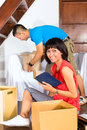 Asian couple moving in the new home real estate market young indonesian a or apartment they unpacking boxes Stock Photos