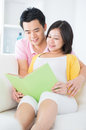 Asian couple reading book Stock Photos