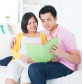 Asian couple reading book together Stock Photos