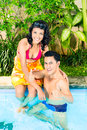 Asian couple swimming in resort pool hotel or club Royalty Free Stock Images