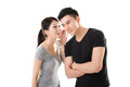 Asian couple whisper Royalty Free Stock Photo