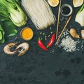 Asian cuisine ingredients over dark slate stone background, square crop Royalty Free Stock Photo