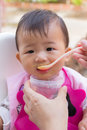 Asian cute baby eating food. Royalty Free Stock Photo