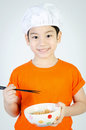Asian cute child eating ramen noodles in ceramic bowl Royalty Free Stock Image