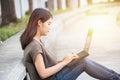 Asian Cute teen women in university using laptop modern lifestyle Royalty Free Stock Photo