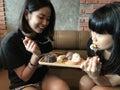 Asian cute teenage woman eating brownie and chocolate icecream. Royalty Free Stock Photo