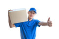 Asian delivery man carrying a parcel box and giving thumbs up Royalty Free Stock Photo
