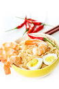 Asian dish close up chines noodle in plate with shrimps and eggs Stock Images