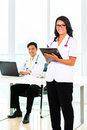 Asian doctor and nurse in surgery or office working medical practice Royalty Free Stock Photos