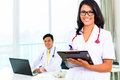 Asian doctor and nurse in surgery or office working medical practice Stock Photos