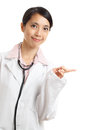 Asian doctor pointing a side isolated on white background Stock Images